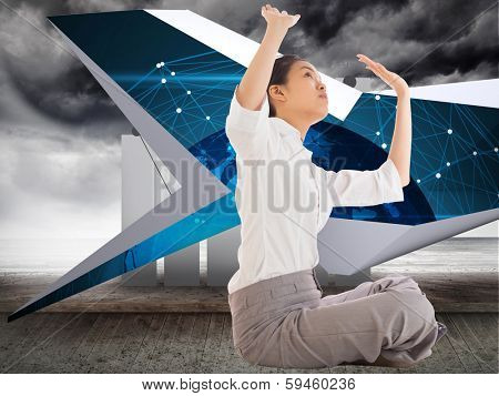 Businesswoman sitting cross legged pushing up against stormy sky on wall with statistic