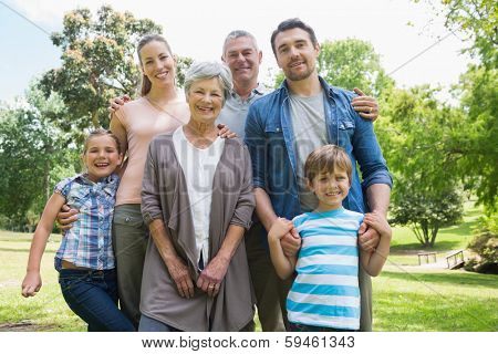 Portrait of a happy extended family standing at the park