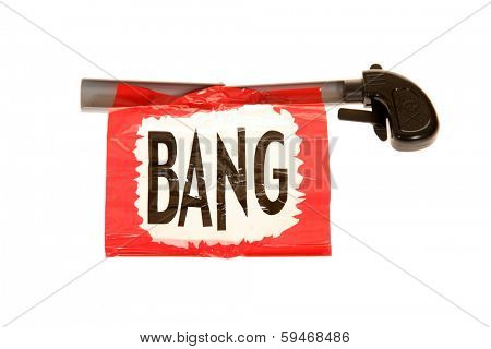 A Genuine Funny Trick Gun with the familiar BANG sign. Clowns and jokers have enjoyed these trick guns for years to make strangers, friends and family laugh and help to enjoy life. Isolated on white