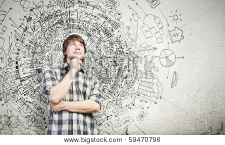 Young thoughtful handsome man in casual thinking over the ideas
