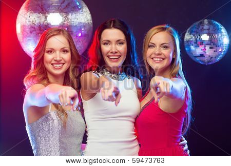 celebration, friends, bachelorette party and birthday concept - three smiling women pointing at you
