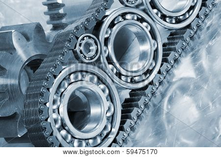ball-bearings and gears powered by large timing-chain, mirrored in titanium