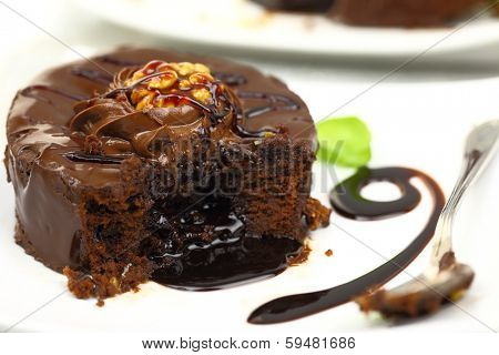 Chocolate dessert with melted chocolate running from inside