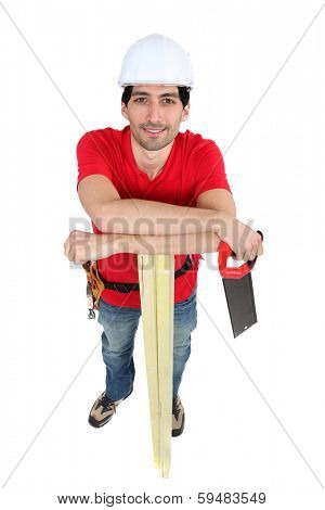 Carpenter holding hand-saw