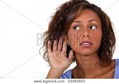 Woman holding hand to ear