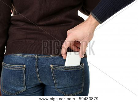 Pickpocket are stealing mobile phone from back pocket, close up, isolated on white