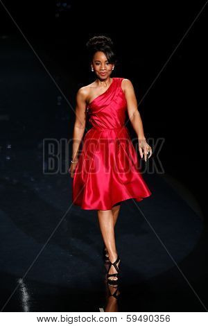 NEW YORK-FEB 6: Anika Noni Rose wears Pamella Roland on the runway at Heart Truth Red Dress Collection show during Mercedes-Benz Fashion Week at Lincoln Center on February 6, 2014 in New York City.