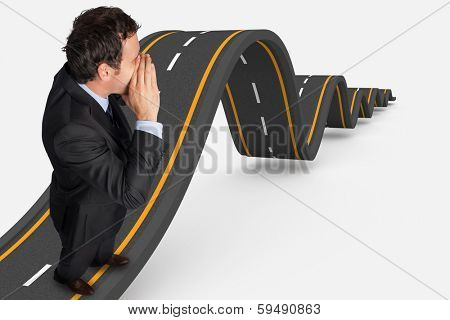 Shouting businessman against bumpy road background