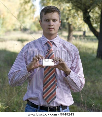 Young Man Handing A Blank Business Card