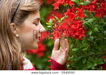 Woman Smelling Florwers