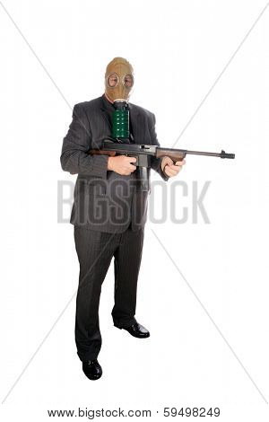 A Well Dressed Man wears a Gas Mask and brandishes a genuine Thompson Sub-Machine Gun. Thompson Sub-Machine Guns AKA Tommy Gun, Chicago Typewriter, and The Chopper fire the .45 APC round.