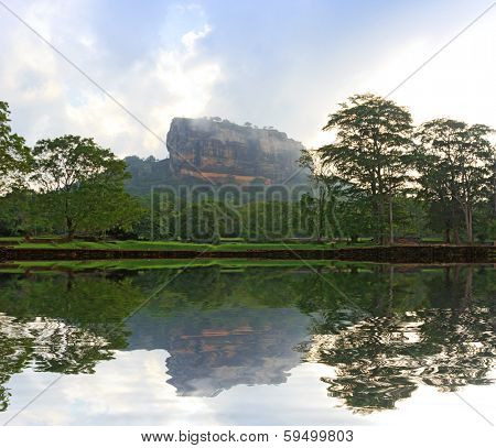 Sigiriya Castle in morning mist and clouds