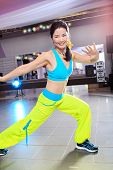 pic of zumba  - young woman in sport dress at an aerobic and zumba exercise