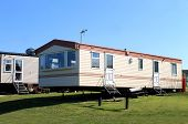 pic of trailer park  - Side view of modern caravans in trailer park - JPG