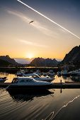 pic of reining  - Yachts and boats near moorage at sunset in Reine village - JPG