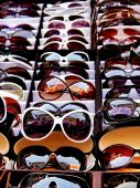 stock photo of peddlers  - Sunglasses for sale at a retail market - JPG