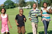 stock photo of pre-adolescent child  - happy African american children running in the park - JPG