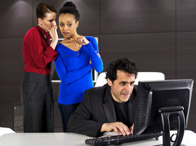 stock photo of indecent  - women gossiping about a man in the office - JPG