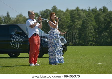 TSELEEVO, MOSCOW REGION, RUSSIA - JULY 26, 2014: Elena Romanova sings the anthem of UK during the opening ceremony of British Polo Day. It was the second British Polo Day in Russia
