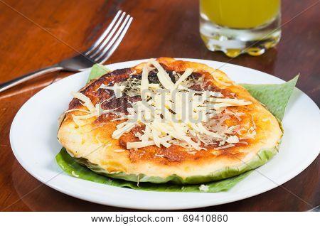 bibingka with cheese on top
