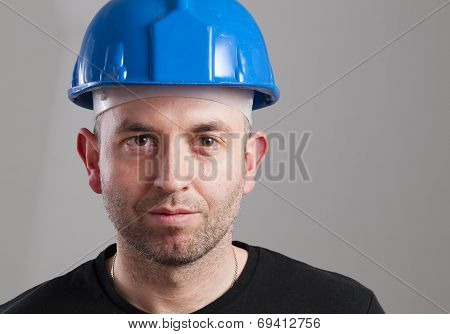 Portrait Of A Worker With Serene Expression