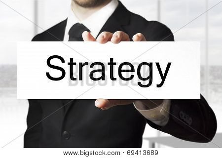 Businessman Holding Sign Strategy