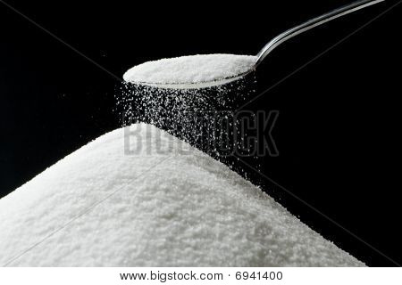 Sugar Falling From Spoon