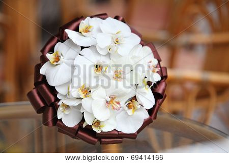 Wedding bouquet. Bouquet of fresh flowers for the wedding ceremony. Bridal bouquet from orchids