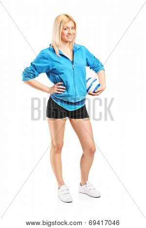 Full length portrait of a professional female handball player isolated on white background