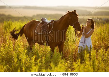 Happy Girl Near To A Horse