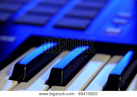 Midi Controller Keyboard In Blue Light