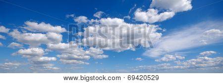 White cumulus clouds and blue sky