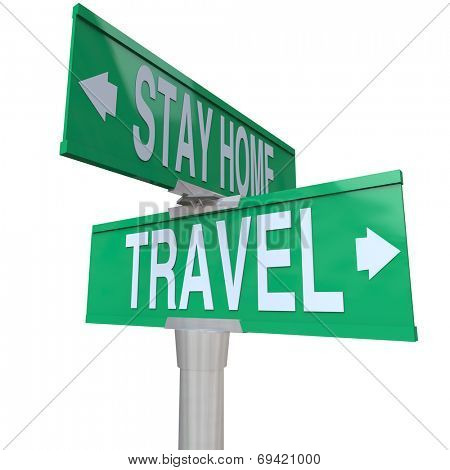 Travel and Stay Home words on green two way road intersection signs as choices to leave for vacation or have a staycation