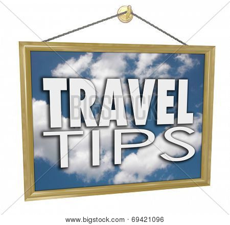 Travel Tips words on a hanging sign with clouds in blue sky advertising helpful tips, advice and information at an agency
