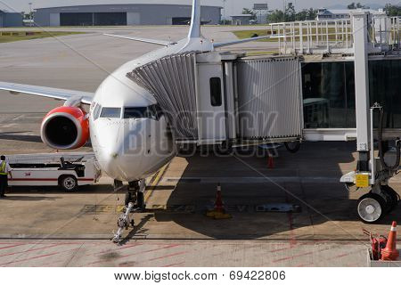 KUCHING - MAY 06: docked jet Airasia airplane on May 06, 2014 in Kuching, Malaysia. AirAsia Berhad is a Malaysian low-cost airline headquartered in Kuala Lumpur, Malaysia