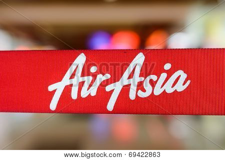 KUCHING - MAY 06: red tape with Airasia inscription on May 06, 2014 in Kuching, Malaysia. AirAsia Berhad is a Malaysian low-cost airline headquartered in Kuala Lumpur, Malaysia