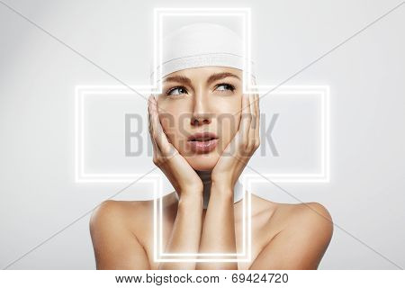 Woman Touching Bandaged Head.