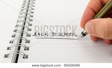 Man Writing - Back To School - In A Journal