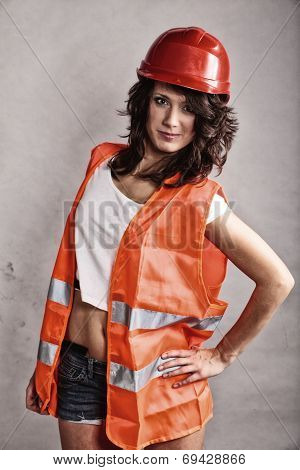 Sexy Girl In Safety Helmet And Orange Vest