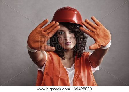 Sexy Girl In Safety Helmet Showing Stop Sign