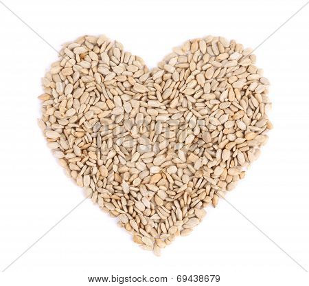 Heart shape of pelled sunflower seeds.