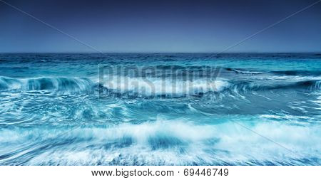 Dramatic stormy seascape, abstract natural background, overcast weather on the sea, big waves, slow motion sea waves