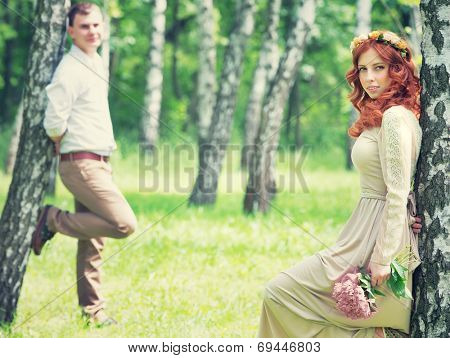Romantic gentle bride and handsome groom posing near birch trees, beautiful young loving couple, summer time, happy wedding day concept