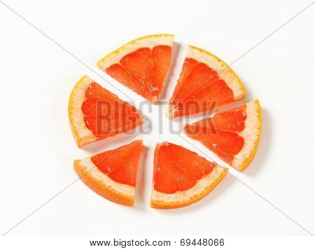 Slice of red grapefruit cut into sixths