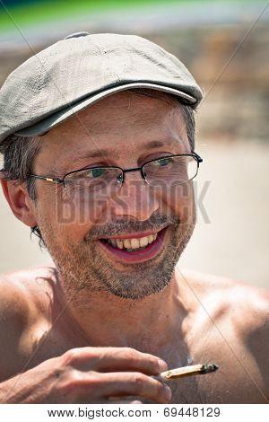 Happy Man Smoking Hashish Joint.