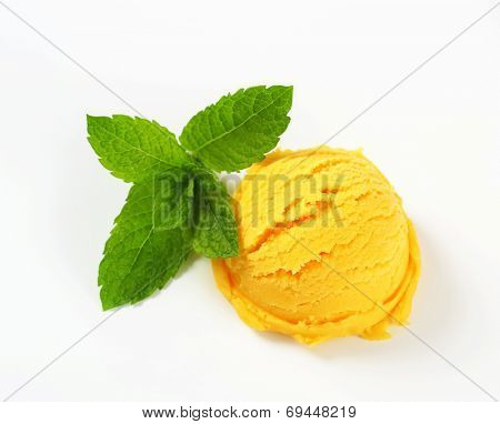 Scoop of yellow ice cream - studio shot