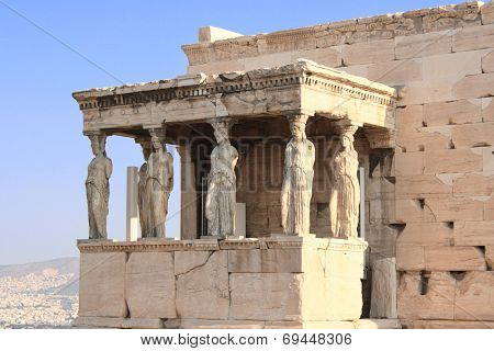 Sunrise lights the side porch of Caryatides in Erechtheum from Athenian Acropolis, Greece