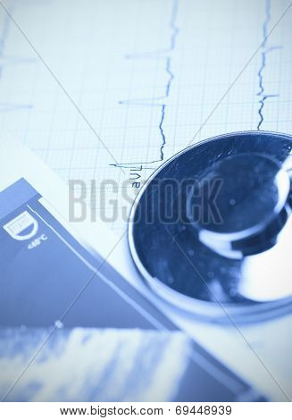 Stethoscope And Ecg Paper. Close-up Photo