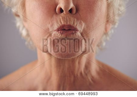 Mature Woman Puckering Lips
