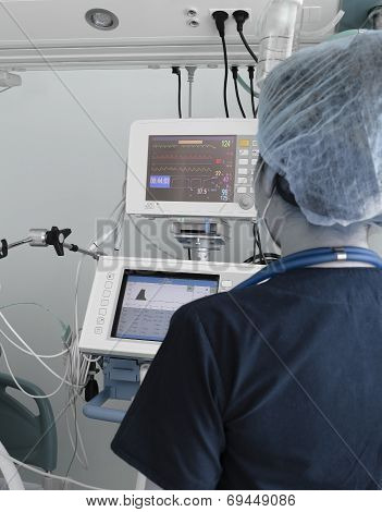 Doctor Woman Working With Electronic Equipment In The Icu